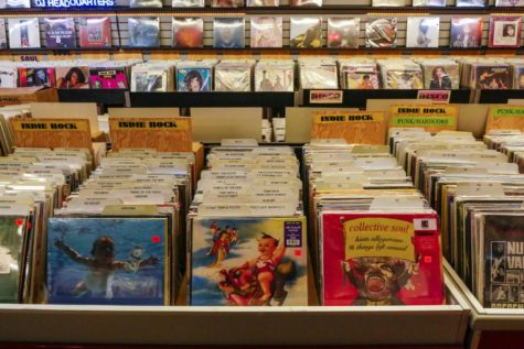 Albums sold at a music store carrying several different bands and artists.